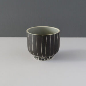 small-black-footed-pinstripe-studio-pottery-vessel