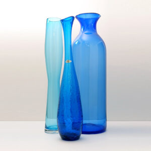 three-very-tall-blue-glass-vases